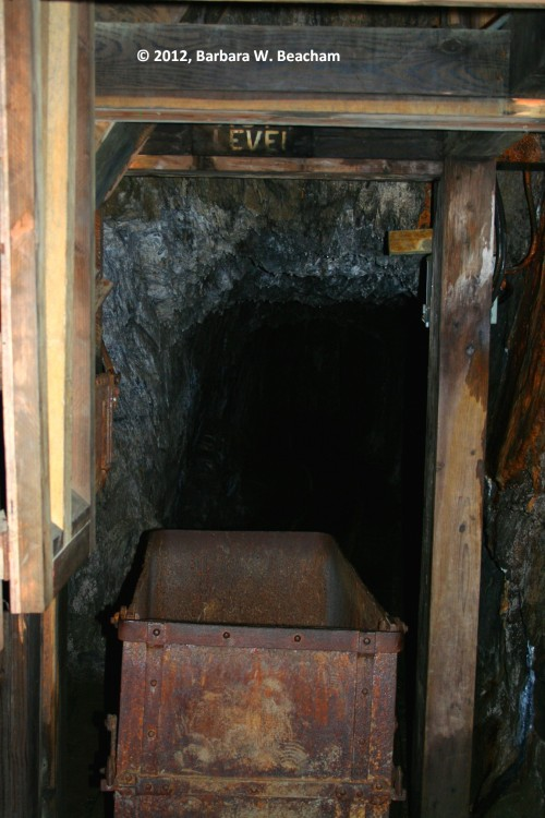 A cart sitting under the air shaft