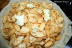 Add the apple mixture to pie pan and dot with butter