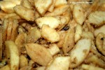 Apples and nuts mixed with flour sugar mixture