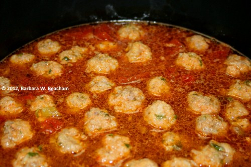 Meatballs added to the broth