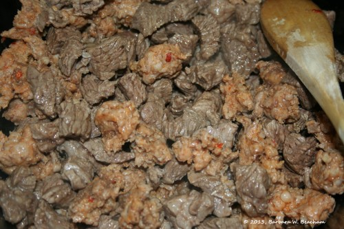The beef and sausage mixed together in the crock pot