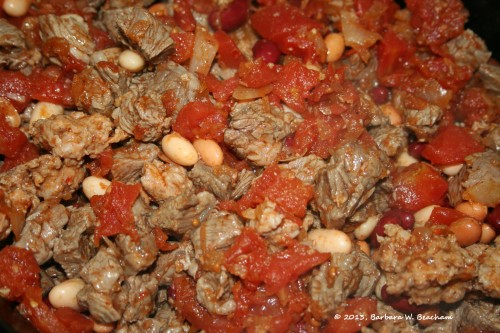 Tomato mixture added to the meat and beans