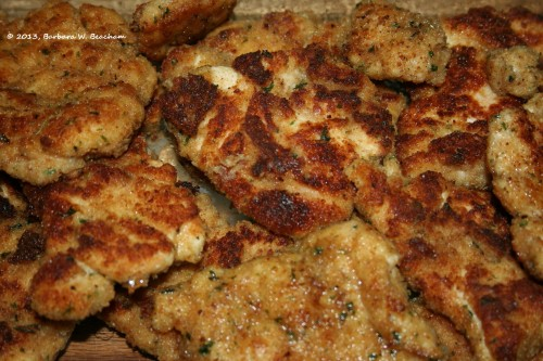 Chicken is cooked and kept warm in the oven