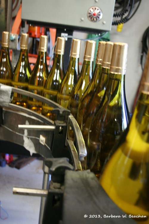 The wine makes its way to the labeler