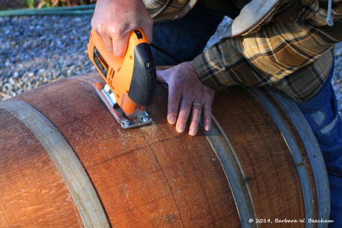 Cutting open a wine barrel