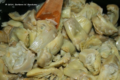Cooking the artichokes with the onion and garlic